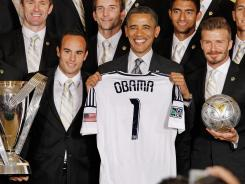 President Obama stands between midfielders Landon Donovan, left, and David Beckham during a reception Tuesday honoring the Major League Soccer champion Los Angeles Galaxy.