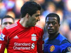 Liverpool striker Luis Suarez, left, was banned for eight matches for directing a racial slur at Manchester United's Patrice Evra.
