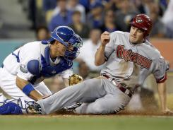 The Diamondbacks' A.J. Pollack is tagged out by Dodgers catcher A.J. Ellis while trying to score from second base on a Willie Bloomquist double in the third inning.