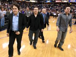 Brothers, George, left, Gavin second from left, and Phil Maloof, co owners of the Sacramento Kings leave the court after the Kings beat the Los Angeles Lakers 113-96 in a NBA basketball game in Sacramento, Calif.