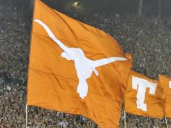 Despite outspending its rivals, Texas is just 13-12 in its past two football seasons.