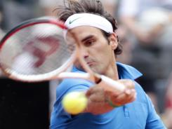Roger Federer of Switzerland raps a forehand during his victory Wednesday against Carlos Berlocq of Argentina at the Italian Open in Rome.