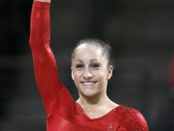 Jordyn Wieber waves to the crowd after winning the gold medal in the senior women's all-around competition at the Pacific Rim Championships in Everett, Wash., on March 16.