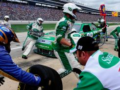 Crew members get Carl Edwards' car ready to return to the track during a Sprint Cup race at Texas Motor Speedway.