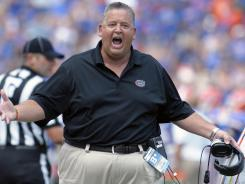 Charlie Weis was offensive coordinator at Florida last season before becoming head coach at Kansas.