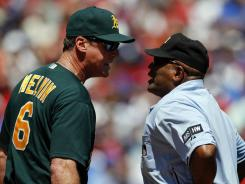 Oakland Athletics manager Bob Melvin argues a call with home-plate umpire Laz Diaz in the sixth inning against the Texas Rangers. Melvin disputed a squeeze bunt and was ejected.