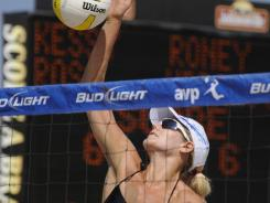 Jen Kessy spikes during the AVP Hermosa Beach Open on Aug. 7, 2009. She and partner April Ross will play in the NVL opener this weekend in Baltimore.