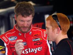 Dale Earnhardt Jr. talks to Cole Whitt, who drives the No. 88 Chevrolet full-time for JR Motorsports, at Daytona International Speedway in February.