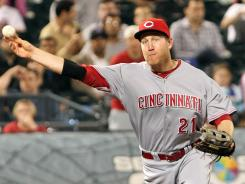 Reds third baseman Todd Frazier, who homered in both the seventh and eighth innings, throws out the Mets' Justin Turner (not pictured) for the first out of the ninth inning.
