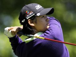 Yani Tseng of Tawain, hitting a tee shot on the sixth hole Thursday, advanced to Round 2 of the Sybase Match Play Championship with a 1-up victory against Jeong Jang of South Korea.