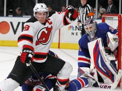 Devils captain Zach Parise (9), corralling the puck in front of Rangers goalie Henrik Lundqvist, says he expected a tight series between the New York-area rivals.