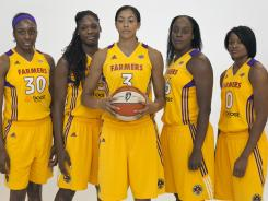 From left, Sparks players Nneka Ogwumike, Nicky Anosike, Candace Parker, Ebony Hoffman and Alana Beard pose for photos during the team's media day in Los Angeles on May 14.