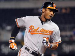 Orioles center fielder Adam Jones runs the bases after hitting a home run in the 15th inning that gave Baltimore a 5-3 win over the Royals.
