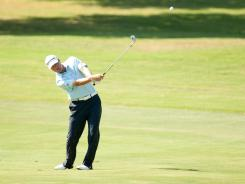 Ryan Palmer plays an approach shot on the eighth hole Thursday at the HP Byron Nelson Championship. Palmer opened with a 6-under 64 to take the first-round lead.