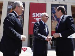 Steve Orsini, left, stands with Larry Brown, center, and SMU President Gerald Turner during Brown's introduction as men's basketball coach on April 23.