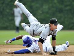 The Cubs' Marlon Byrd takes out the White Sox's Gordon Beckham during a 2011 Chicago vs. Chicago interleague game.