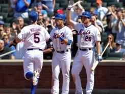 Mets' David Wright, left, and Andres Torres score during the fifth inning against the Reds.