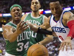 Boston Celtics forward Paul Pierce (34) and Philadelphia 76ers forward Andre Iguodala (9) go for a loose ball during the first quarter in Game 4 in the Eastern Conference semifinals Friday night at Philadelphia.