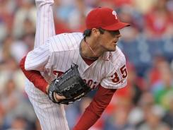 Philadelphia Phillies starting pitcher Cole Hamels improved to 4-0 lifetime against the Boston Red Sox with a win Friday night.