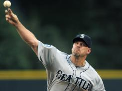 Mariners starting pitcher Kevin Millwood threw the 22nd complete game of his career in 4-0 win Friday against the Colorado Rockies.