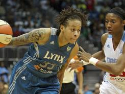 Minnesota Lynx guard Seimone Augustus, left, drives the ball past the defense of Atlanta Dream guard Angel McCoughtry during Game 3 of the WNBA Finals. The Lynx went on to win the 2011 WNBA championship and return in 2012 as favorites to repeat.