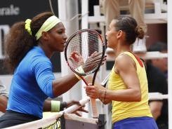 Serena Williams of the USA shakes hands with Flavia Pennetta of Italy after Pennetta retired from the quarterfinal match with a wrist injury Friday.