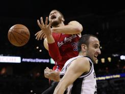 The Los Angeles Clippers forward Blake Griffin (32) gets fouled while shooting against San Antonio Spurs guard Manu Ginobili (20) during the first half Game 2 on Thursday at San Antonio.
