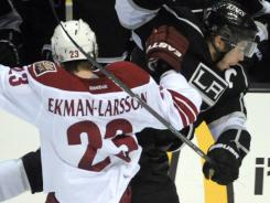 Phoenix Coyotes defenseman Oliver Ekman-Larsson was penalized for this battle with Los Angeles' Dustin Brown in the third period.