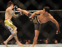 Renan Barao, right, defeated Scott Jorgensen in February.