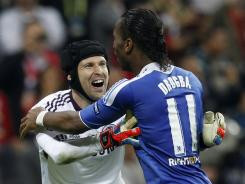 Chelsea goalkeeper Petr Cech celebrates with Didier Drogba after winning the Champions League finale. Drogba netted the decisive shootout goal after the clubs played a 1-1 draw.