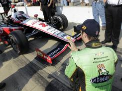 IndyCar driver James Hinchcliffe, right, jokes with Indy 500 pole-sitter Ryan Briscoe to slow down during Saturday's qualifying.