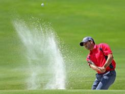 Sergio Garcia of Spain plays a bunker shot on the 14th hole during his quarterfinal loss to Graeme McDowell at the Volvo World Match Play Championship.