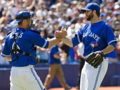 Blue Jays starter Brandon Morrow, right, celebrates with catcher Jeff Mathis after shutting out the New York Mets 2-0 on Saturday in Toronto.