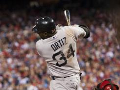 Red Sox first baseman David Ortiz (34) hits a home run during the fifth inning against the Phillies. Ortiz is hitting .344 this season with nine home runs.