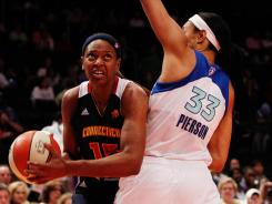 Connecticut forward Asjha Jones (15) drives the ball around New York forward Plenette Pierson (33) during the Sun's victory over the Liberty on Saturday at Madison Square Garden.