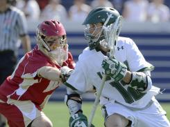Denver goalie Ryan LaPlante (10) chases Loyola's Eric Lusby (12) during the second half. Loyola (Maryland) held on to defeat Denver 10-9 in Annapolis, Maryland on Saturday.
