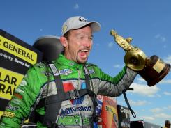 Jack Beckman celebrates after winning the Funny Car finals Sunday at the NHRA Summernationals at Heartland Park Topeka.