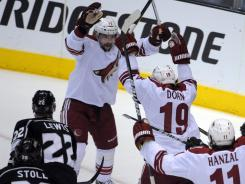 Phoenix Coyotes right wing Shane Doan (19) celebrates after scoring a first-period goal Sunday.