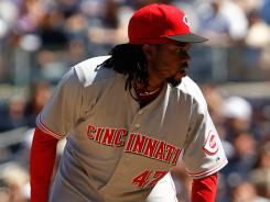 Cincinnati's Johnny Cueto picked up his fifth win of the season Sunday, allowing two runs in seven innings as the Reds defeated the Yankees 5-2.
