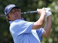 Jason Dufner hits from the first tee during the final round of the HP Byron Nelson Championship on Sunday.