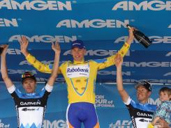 Robert Gesink of the Netherlands, celebrates on the podium with second-place finisher David Zabriskie, left, and third-place finisher Tom Danielson after the end of the Amgen Tour of California.