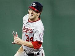 The Nationals' Bryce Harper, above, was plunked May 6 by Cole Hamels.