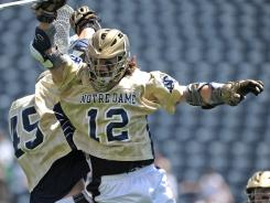 Notre Dame's Westy Hopkins, right, celebrates a first-half goal with Max Pfeifer, who had three goals of his own Sunday.