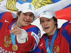 Alexander Semin (two goals) and Washington Capitals teammate celebrate their win against Slovakia in the world championship final.