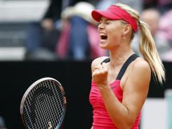 Maria Sharapova of Russia enjoys a moment during her victory against Li Na of China in the final of the Italian Open on a rainy Sunday in Rome.