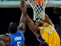 Oklahoma City Thunder center Kendrick Perkins (5) fouls Lakers shooting guard Kobe Bryant (24) in the first half of Game 4 on Saturday at Los Angeles.