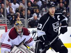 Dustin Brown and Kings teammates hope to get a puck past Coyotes goalie Mike Smith in Game 5.