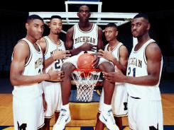 In this file photo taken November 1991, Michigan's Fab Five from left, Jimmy King, Juwan Howard, Chris Webber, Jalen Rose and Ray Jackson pose in Ann Arbor, Mich.