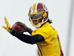 Coaches and veterans were impressed with Robert Griffin III in his first full practice with the Redskins.