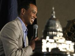 Tiger Woods speaks to the media at an AT&T National news conference Monday at Congressional Country Club in Bethesda, Md.